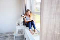 Child reading book at home stock photos