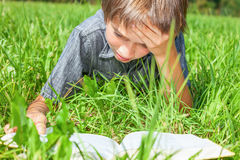 Child reading book outdoor Stock Photos