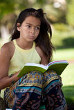 Child reading a book at the park Royalty Free Stock Photo