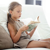Child reading book Royalty Free Stock Photo