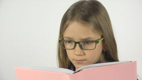 Child Reading a Book, Schoolgirl Studying, Eyeglasses Portrait Student Kid Learn stock photos