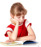 Child reading book on white isolated. Stock Photo