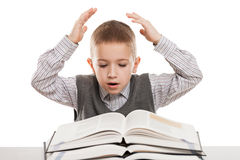 Child reading books. Amazed or surprised boy reading education books at desk Royalty Free Stock Photos