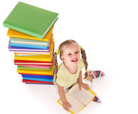 Child reading group of books. Stock Photography