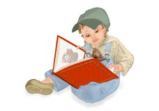 The child is reading with his kitten. The child is reading a story while his kitten is playing Royalty Free Stock Photo