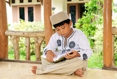 Child Reading Koran, Indonesia Stock Images