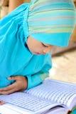 Child Reading Koran, Indonesia Royalty Free Stock Photo
