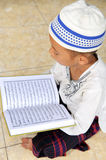 Child Reading Koran, Indonesia Stock Photography