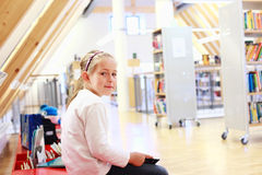 Child reading in library Stock Photo