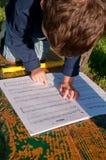 Child reading music Stock Photo