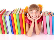 Child reading open  book on table. Royalty Free Stock Images