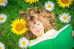 Child reading in park Stock Photo