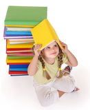 Child reading pile of books. Stock Image