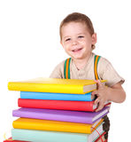 Child reading pile of books. Royalty Free Stock Images