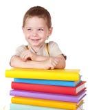 Child reading pile of books. royalty free stock photo