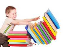 Child reading pile of books. Royalty Free Stock Photography