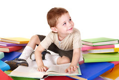 Child reading pile of books. Royalty Free Stock Photos