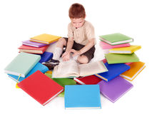 Child reading pile of books. Royalty Free Stock Photo