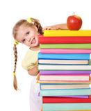 Child reading  pile of books. Stock Images