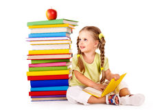 Child reading  pile of books. Stock Photos