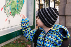 Child reading public map Royalty Free Stock Image