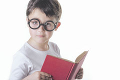Child reading. Smart boy reading a book Royalty Free Stock Photos