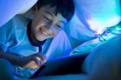 Child reading stock photography