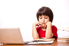 Child reading a textbook Stock Photo