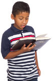 Child Reading the Word of God Attentively Stock Image