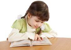 Child  reads. Stock Photography