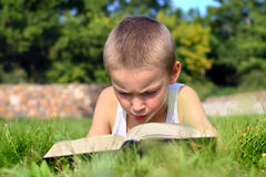 Child reads book Royalty Free Stock Photos