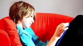 Child reads a book stock footage