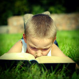 Child reads a Book Stock Images