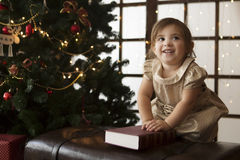 The child reads Christmas Stock Images
