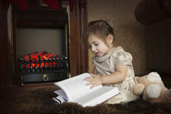 The child reads Christmas fairy tales Royalty Free Stock Photos