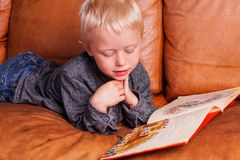 Child reads in one Book Royalty Free Stock Photo