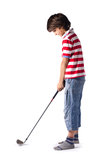 Child ready to hit golf ball with club. On white Stock Photos