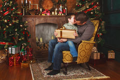 Child received a gift from his father. N Stock Image