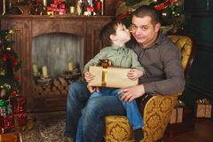 Child received a gift from his father. N Royalty Free Stock Image