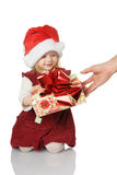 The child receives a gift Royalty Free Stock Photography