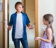 Child receiving expected friend at home interior Stock Image