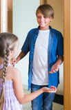 Child receiving expected friend at home interior Royalty Free Stock Photography