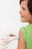 Child receiving vaccine with smile on his face Royalty Free Stock Image