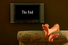 Free Child Reclining Feet Up Watching The End Of A Movie Stock Photo - 247680