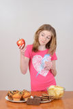 Child with a red apple royalty free stock photos