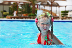 Child in red bikini and glasses swimming. Royalty Free Stock Image