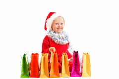 Child  in red cap with presents Stock Photo