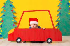 Child in red Christmas car. Xmas holiday concept Royalty Free Stock Images