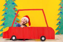 Child in red Christmas car. Xmas holiday concept Royalty Free Stock Image