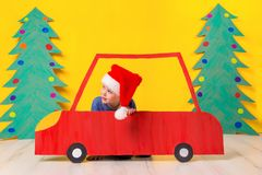 Child in red Christmas car. Xmas holiday concept Stock Image